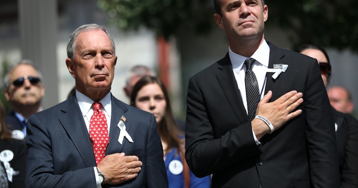New York City Mayor Michael Bloomberg (L) and 9/11 Memorial and Museum president Joe Daniels listen as a bugler plays Taps at the close of the ceremony marking the eleventh anniversary of the terrorist attacks on lower Manhattan at the World Trade Center on September 11, 2012 in New York City. New York City and the nation are commemorating the eleventh anniversary of the September 11, 2001 attacks which resulted in the deaths of nearly 3,000 people after two hijacked planes crashed into the World Trade Center, one into the Pentagon in Arlington, Virginia and one crash landed in Shanksville, Pennsylvania.</p>