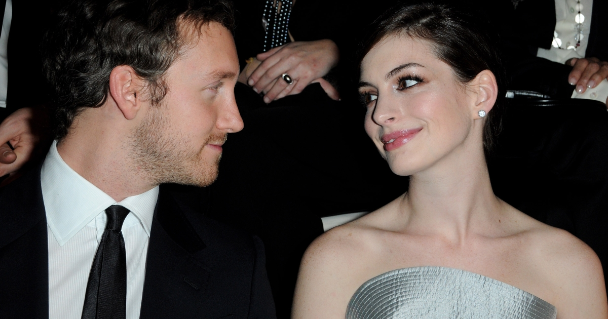 Actor Adam Schulman and Actress Anne Hathaway (R) attend Giorgio Armani Prive Fashion Show during Paris Fashion Week Haute Couture S/S 2010 at Palais de Chaillot on January 25, 2010 in Paris, France.</p>
