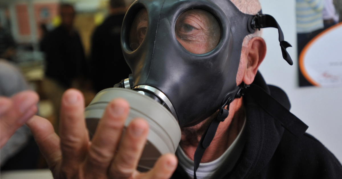 An Israeli man tries a gas mask at a distribution centre in Or-Yehuda, south of Tel Aviv on February 28, 2010. Israel began distributing new gas masks for use in a possible chemical or biological attack, the army said.</p>