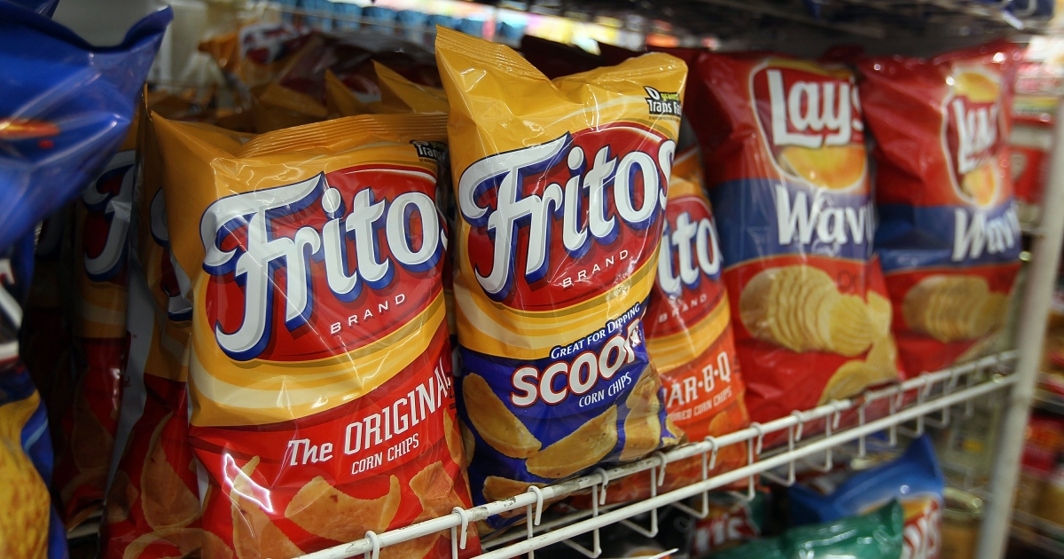 Bags of chips manufactured by PepsiCo Frito-Lay brand are seen on a shelf on March 22, 2010 in Miami, Florida.</p>