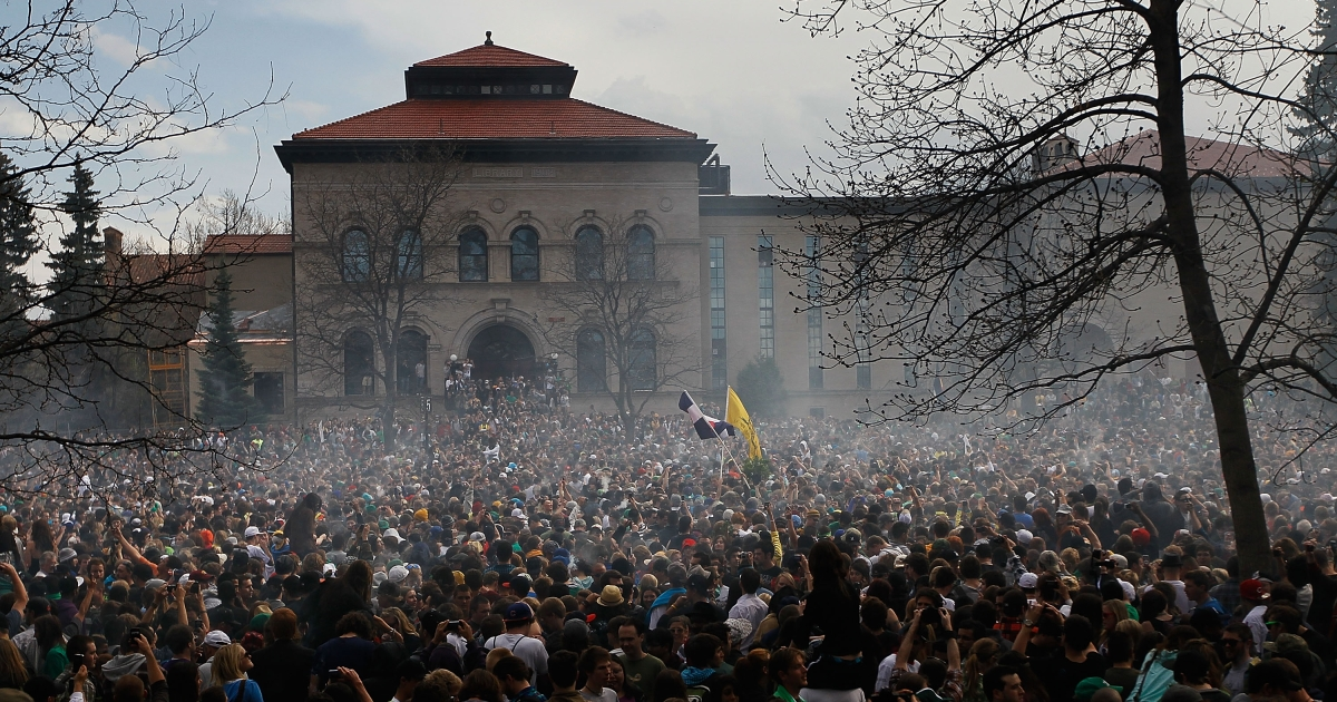 The haze of marijuana smoke looms over a crowd of thousands at 4:20 pm April 20, 2010 at the University of Colorado in Boulder, Colorado.</p>