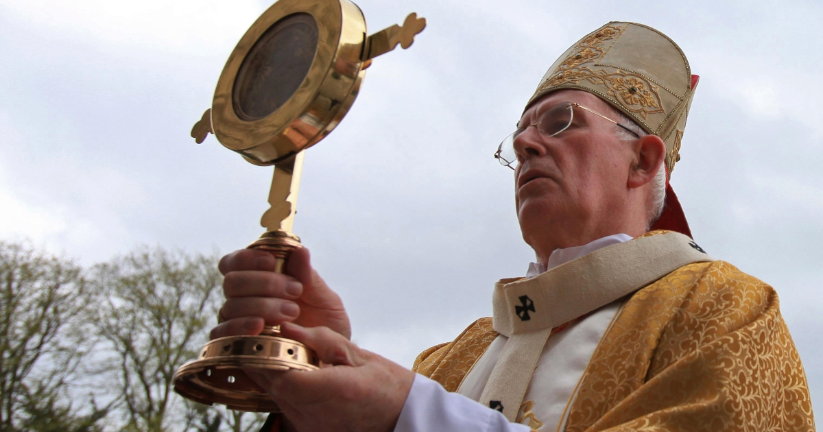 Catholic Bishop Sean Brady carries the relics of St John Vianney, the Patron Saint of Parish Priests, during a procession into a service at St Patrick's Cathedral in Armagh, Northern Ireland on April 28, 2010.</p>