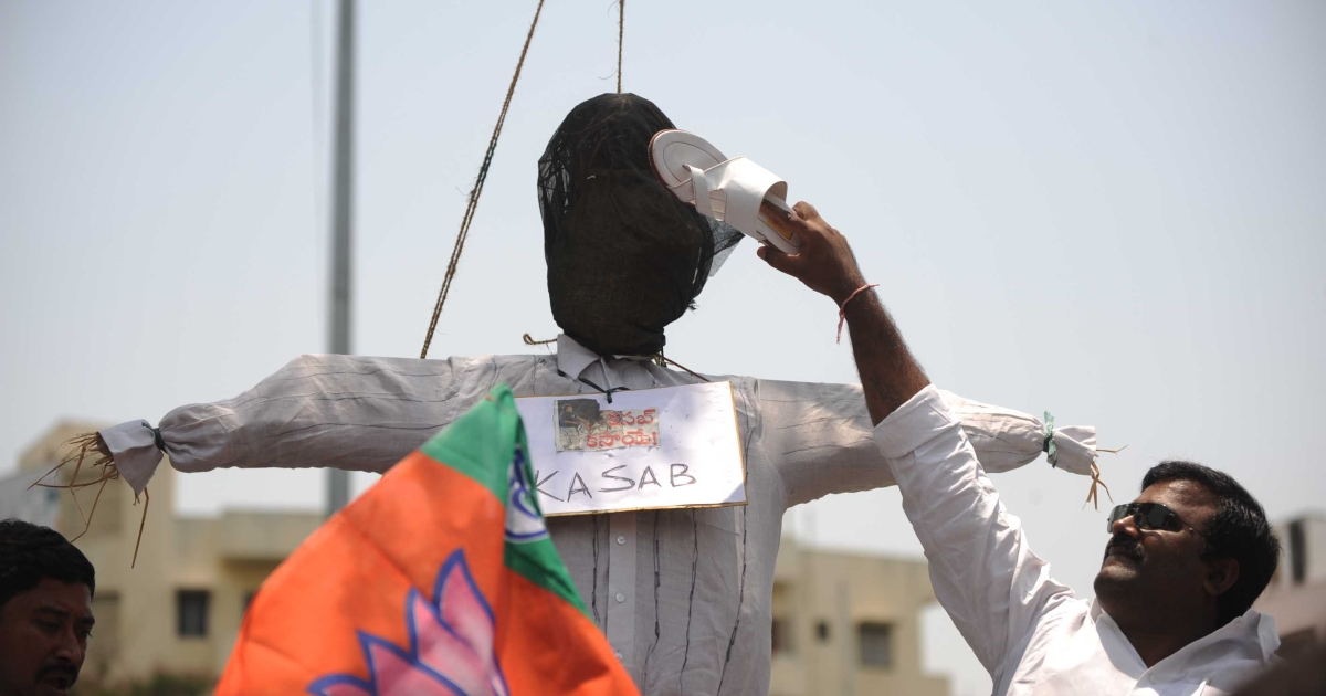 An Indian activist of the main opposition Bharatiya Janata Party (BJP) uses a shoe to hit an effigy representing Pakistani Mohammed Ajmal Kasab in Hyderabad on May 7, 2010, to celebrate the death sentence verdict handed down to Kasab.</p>