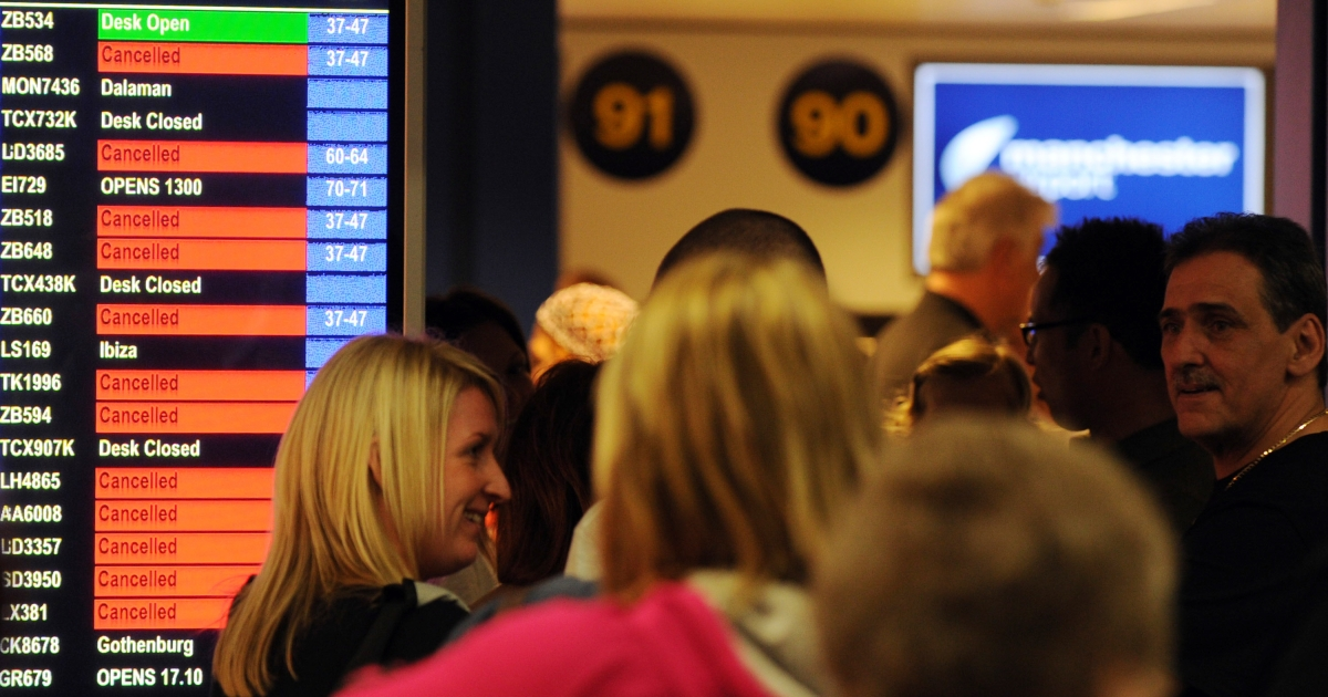 Pasengers wait for flight information as Manchester Airport, in Manchester, north-west England on May 16, 2010.</p>