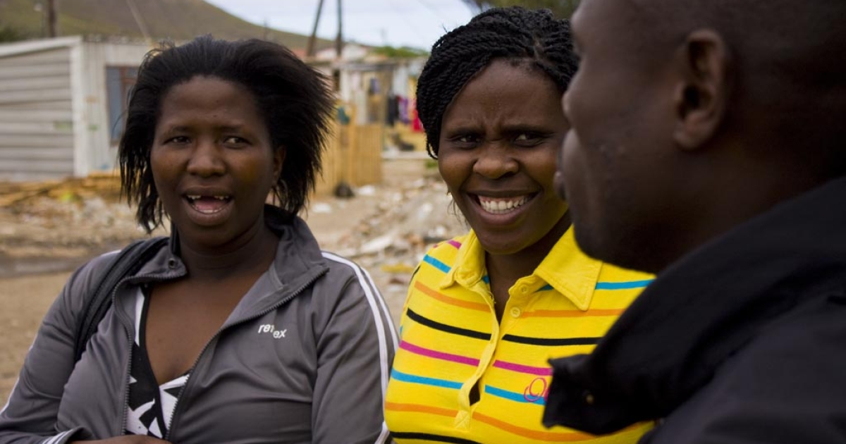 Sizophila-trained counselors recruit volunteers near the Desmond and Leah Tutu Research Clinic in Masiphumelele, South Africa.</p>