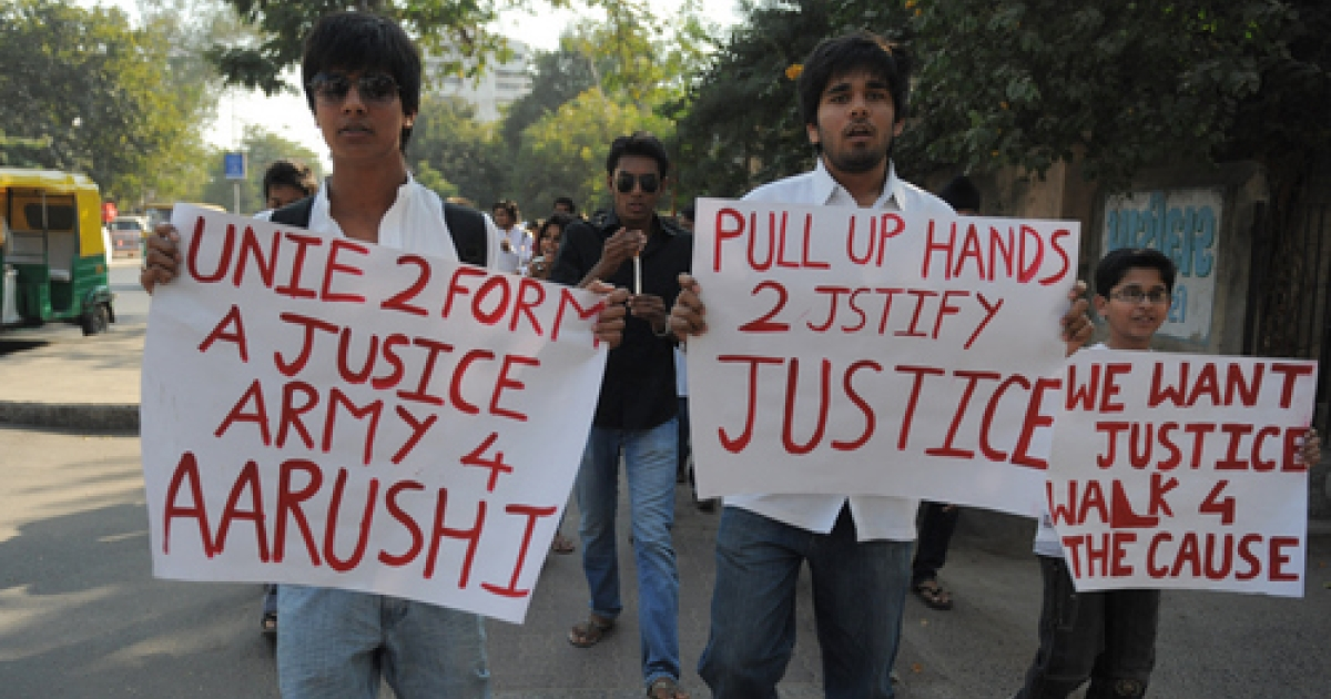 Indian students participate in a support demonstration for late Aarushi Talwar in Ahmedabad on January 30, 2011. Aarushi was found with her throat slit and battered skull at her residence in the town of Noida on May 16, 2008 and the body of family helper Hemraj was discovered a day later.</p>