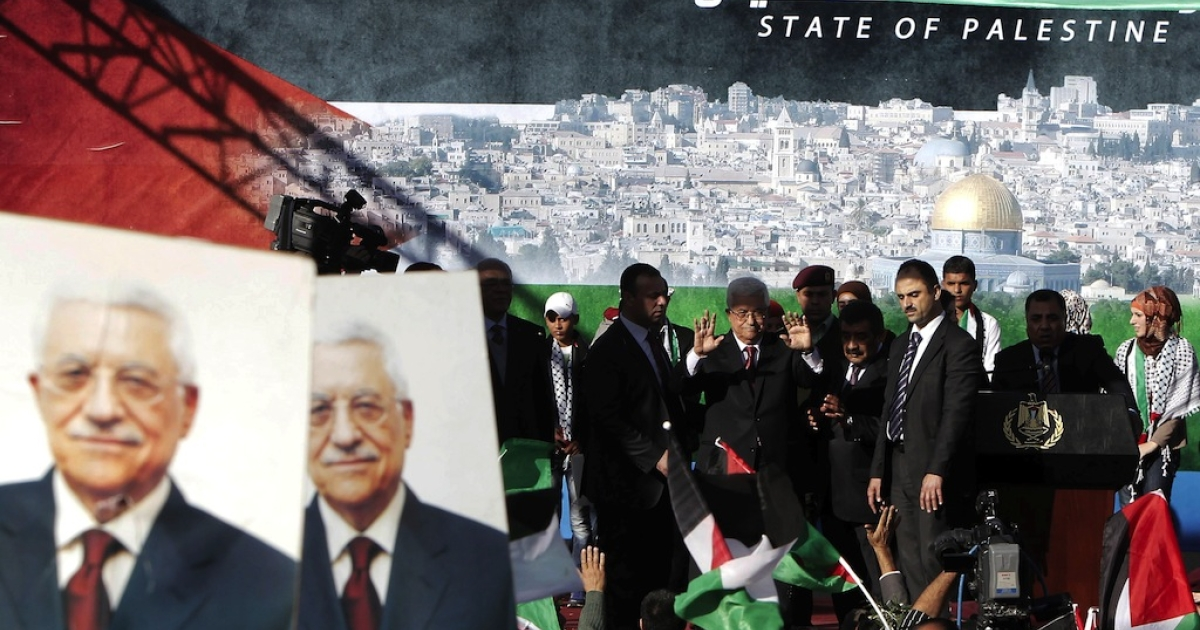 Palestinian president Mahmud Abbas gestures as he arrives to addresses the crowds as Palestinians celebrate his successful bid to win U.N. statehood recognition in the West Bank city of Ramallah on December 2, 2012. Israel announced on Sunday that it was withholding millions of dollars in tax revenue from Palestine in protest against the vote.</p>