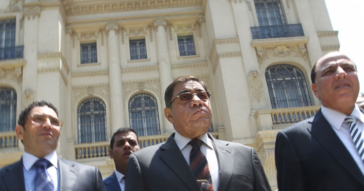 Egypt's Prosecutor General Abdel Meguid Mahmud (C) leaves after speaking to journalists following his inspection of the Mohammed Mahmoud Khalil Museum (background) in Cairo on August 22, 2010.</p>