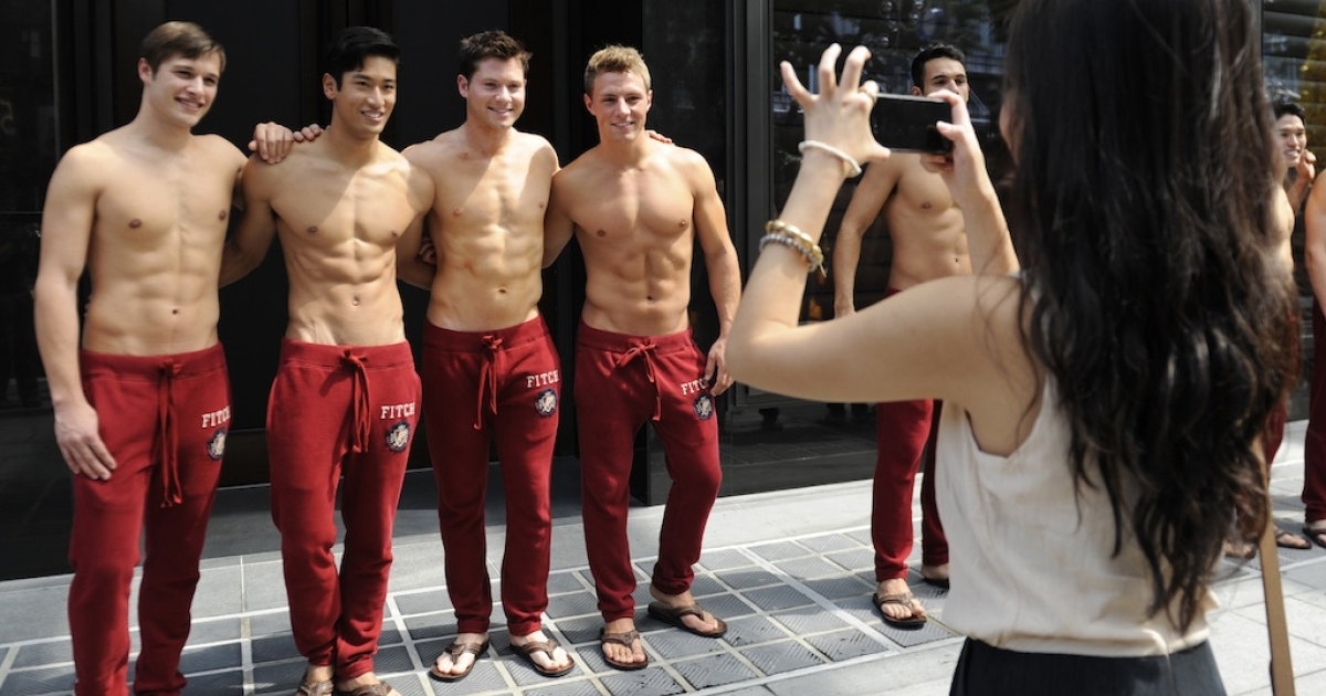 Abercrombie &amp; Fitch models pose outside the A&amp;F store in Knightsbridge, a shopping mall in Singapore, on December 9, 2011.</p>