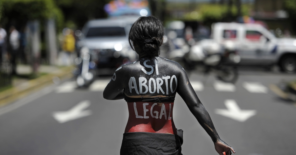 A woman participates in a march on the International Day of Action for the Decriminalization of Abortion, on Sept. 28, 2012 in San Salvador.</p>