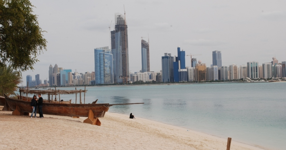 The Abu Dhabi skyline seen from Heritage Village, a mock-Bedouin village across the Bay.</p>