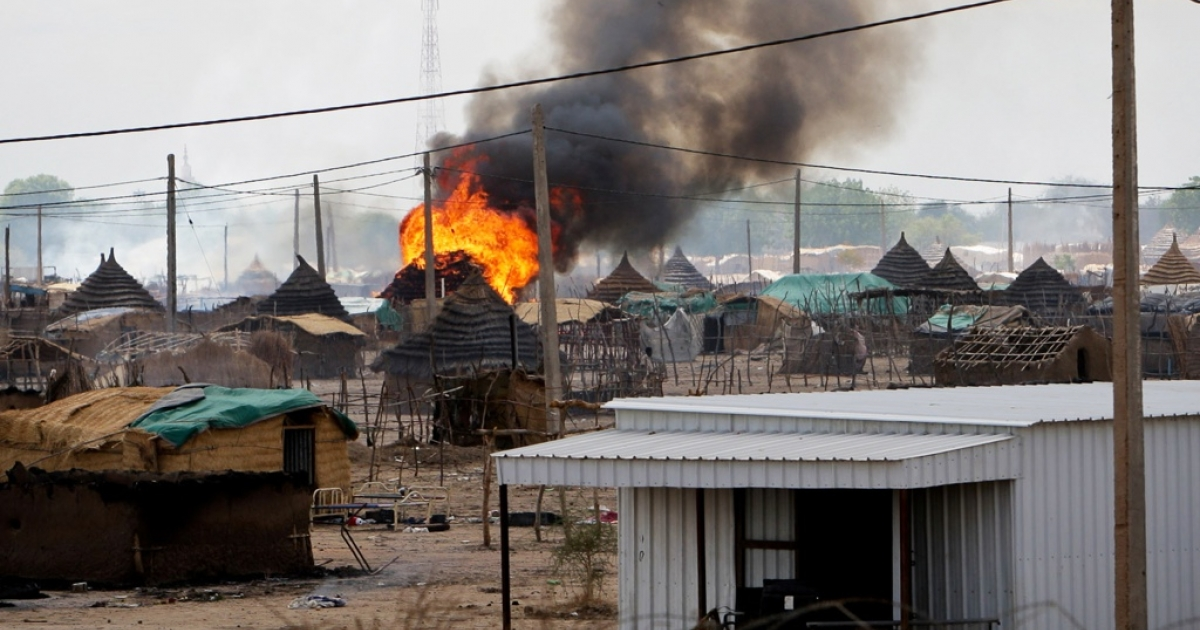 Burning homes in Abyei town. The UN said it strongly condemns the burning and looting currently being perpetrated by armed elements in Abyei following the seizure of the town by Northern Sudanese.</p>