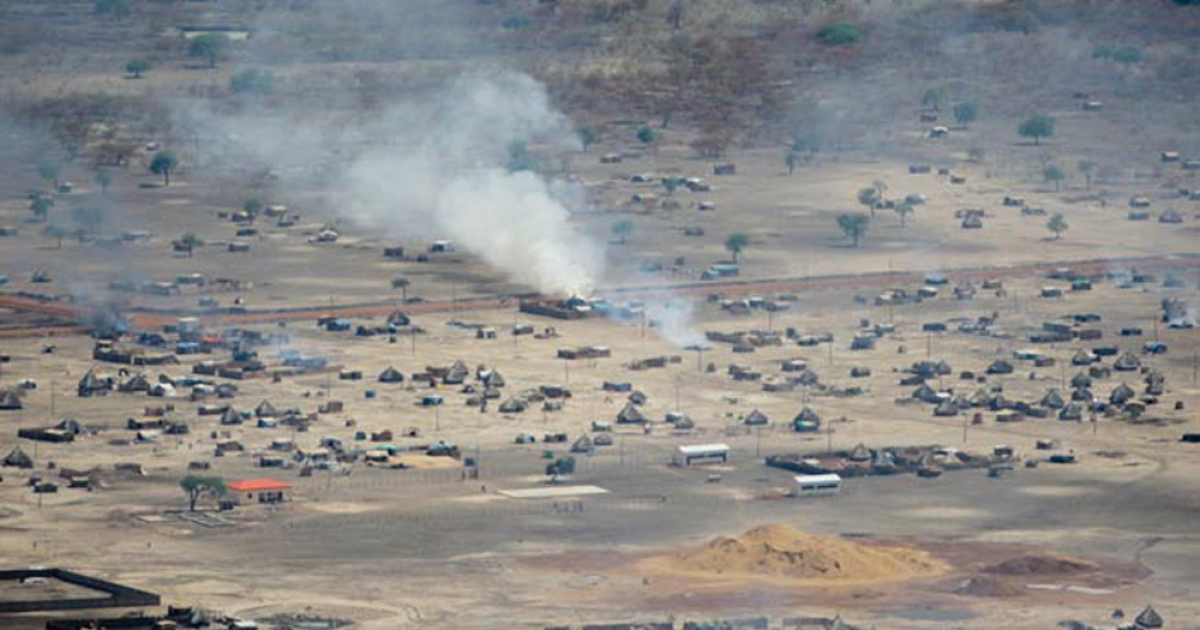 After the occupation: this aerial photograph taken by the UN shows the town of Abyei on fire after troops from northern Sudan invaded at the weekend.</p>