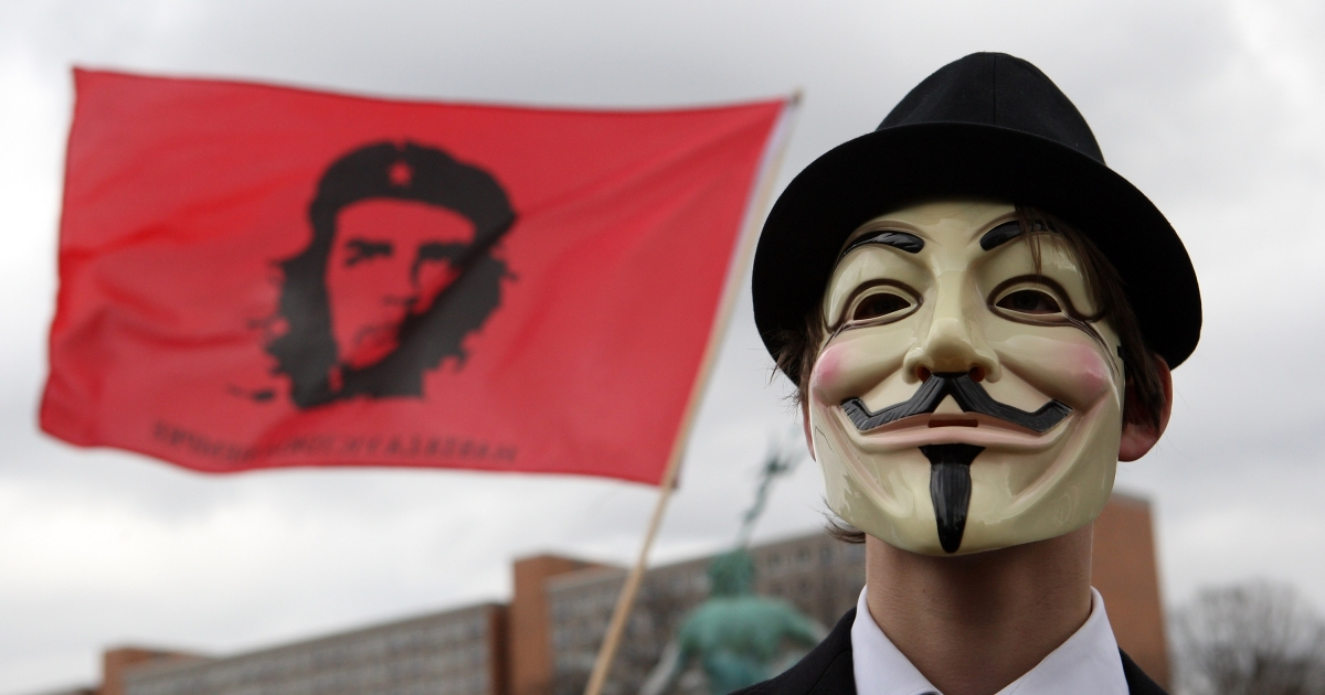 An activist in a Guy Fawkes mask protests during a demonstration against the Anti-Counterfeiting Trade Agreement (ACTA) on February 25, 2012 in Berlin, Germany.</p>