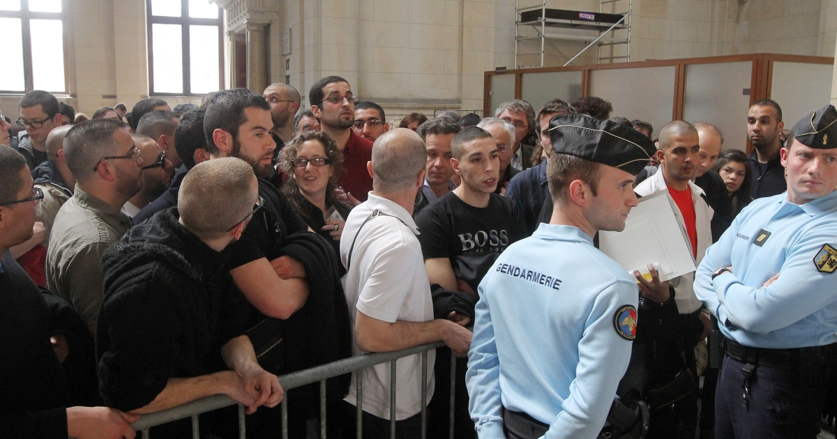 People wait to attend the trial of Franco-Algerian physicist Adlene Hicheur, who formerly worked for CERN (European Centre for Nuclear Research) in Switzerland, on March 29, 2012 in Paris.</p>