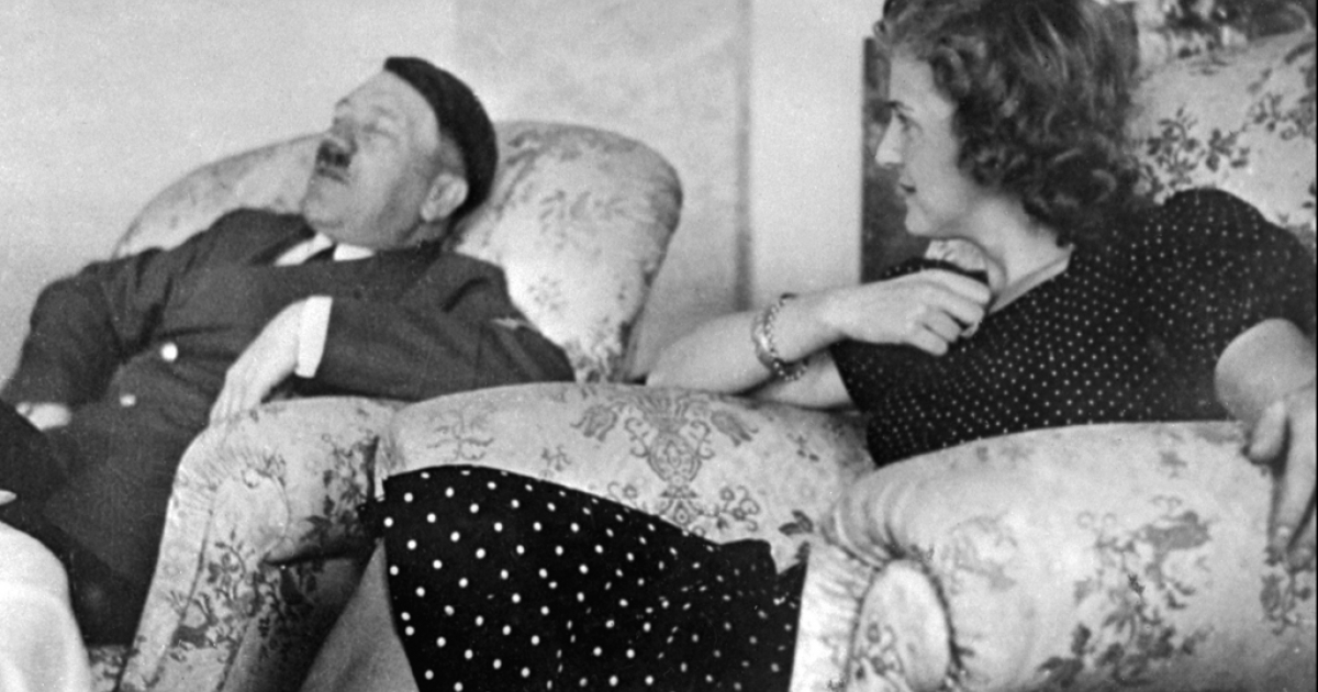 Adolf Hitler relaxes with his mistress Eva Braun in this undated file photo.</p>