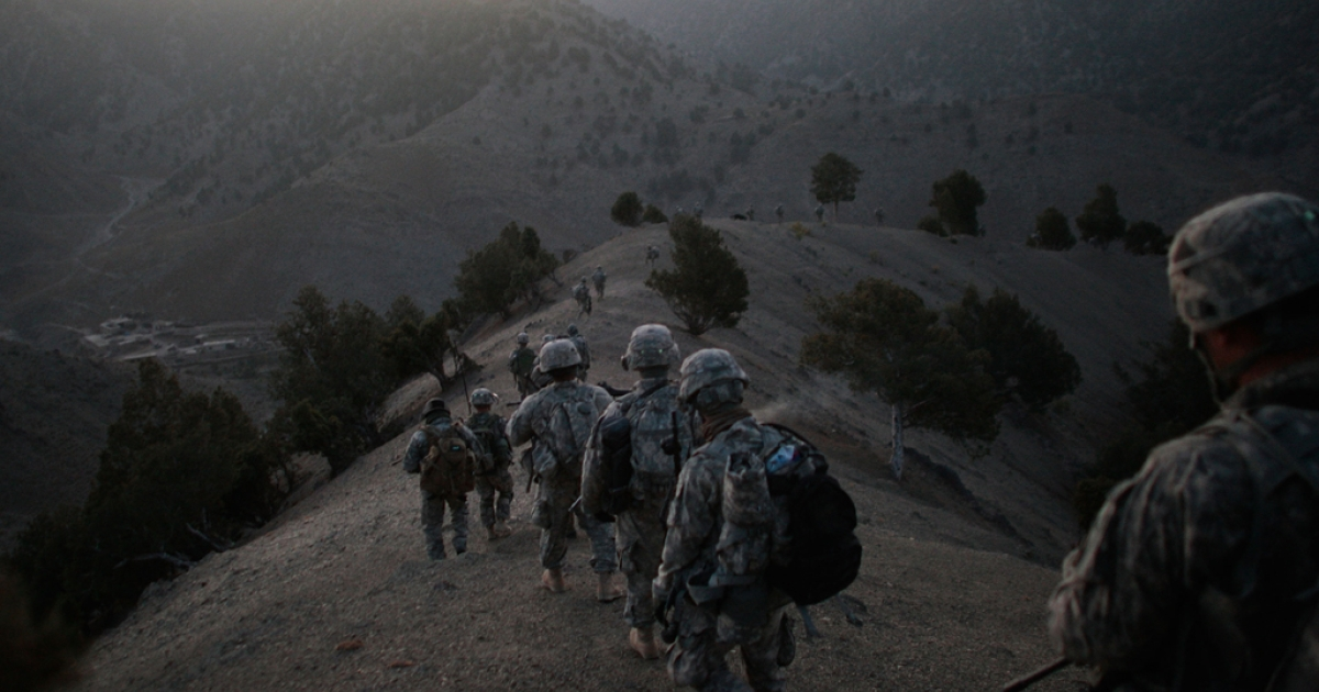 Soldiers in the 1/501st of the 25th Infantry Division file off the ridge of a mountain where they spent the night in a Taliban stronghold area.</p>