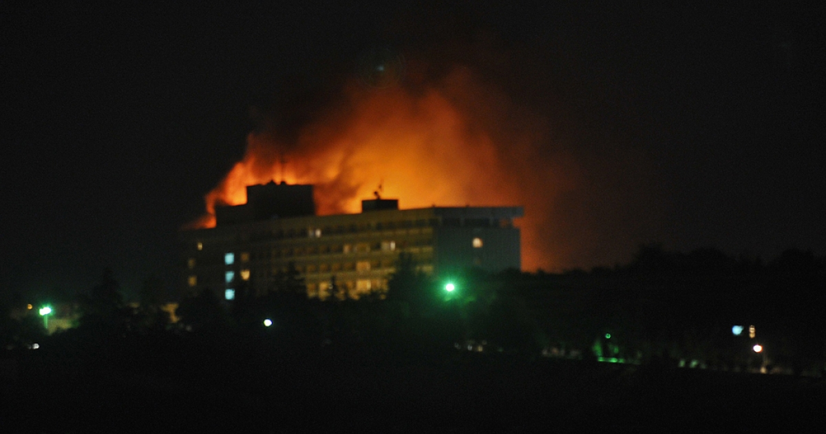 Smoke and flames light up the night from a blaze at the Intercontinental hotel after an attack on the hotel by Taliban fighters and a response by Afghan security forces backed by NATO helicopters in Kabul.</p>