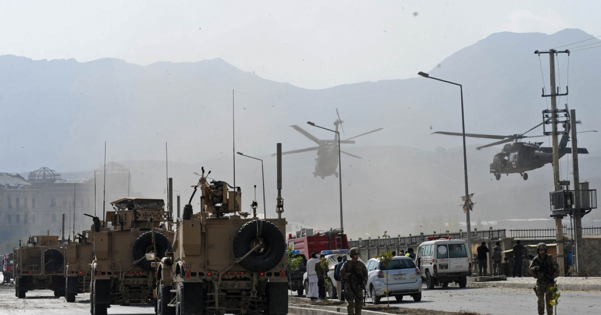 Two NATO helicopters land on site of a suicide attack near Darul Aman palace in Kabul on October 29, 2011.</p>