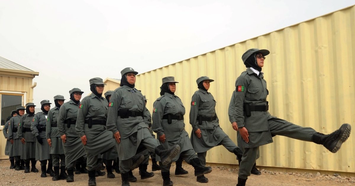 Afghan policewomen march during a graduation ceremony at a police training centre in Herat on March 15, 2012. Some 270 officers including 27 females graduated following their eight-week training course at Ansar 606 police training centre in the western province of Herat. The Afghan government wants to take control of the country's security from the United States in 2013 and not 2014 as previously planned, President Hamid Karzai's spokesman said.</p>