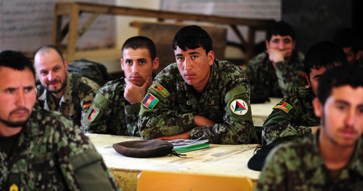 Afghan National Army (ANA) soldiers attend a lesson about radio on March 24, 2012. Ten suicide vests were reportedly discovered at the Afghan Defense Ministry on March 27, 2012, prompting a lockdown and the arrests of more than a dozen Afghan soldiers suspected of plotting a suicide attack.</p>