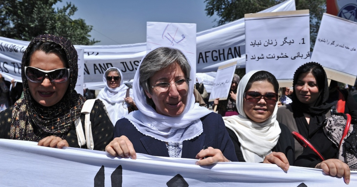 Afghanistan head of Human Rights Commision Seema Samar (C) marches with Afghan women to protest the recent public execution of a young woman for alleged adultery, in Kabul on July 11, 2012. Dozens of Afghan women's rights activists took to the streets to protest the recent public execution of a young woman for alleged adultery, which was captured in a horrific video.</p>