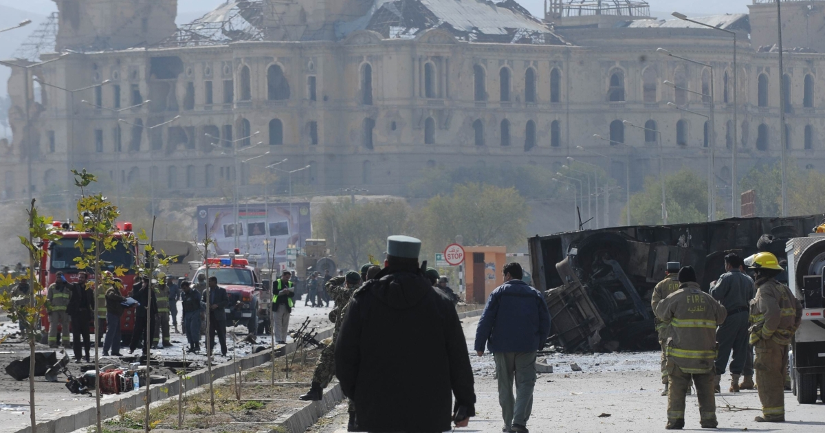 Afghanistan's security force and rescue personnel inspect the site of a suicide attack near the Darul Aman palace (back) in Kabul on October 29, 2011. At least 17 people, including foreign forces, were killed when a Taliban car bomber struck a US-run NATO convoy traveling through the Afghan capital Kabul.</p>