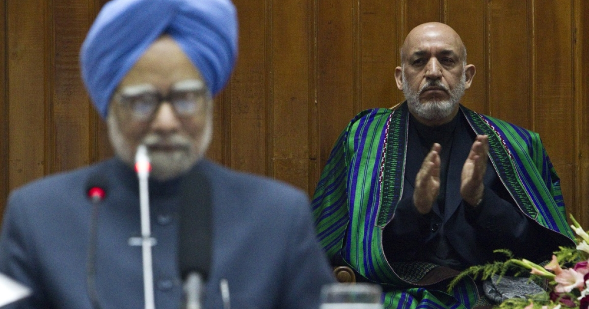 India's Prime Minister Manmohan Singh speaks at a session of the Afghan parliament in Kabul on May 13, 2011 as Afghan President Hamid Karzai watches.</p>