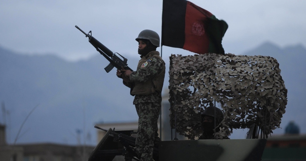 Afghanistan soldier standing guard in Kabul after a suicide attack on an Army bus injured 7 soldiers and 3 civilians on 9 April, 2011. The Afghan Army as well as international forces are braced for more such attacks as the spring fighting season begins.</p>