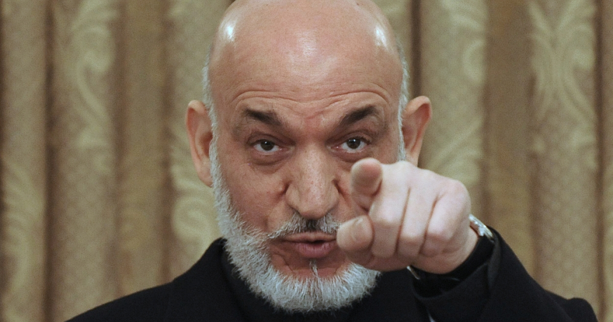 Afghan President Hamid Karzai talks during a press conference at the Presidential Palace in Kabul on Apirl 11, 2011.</p>