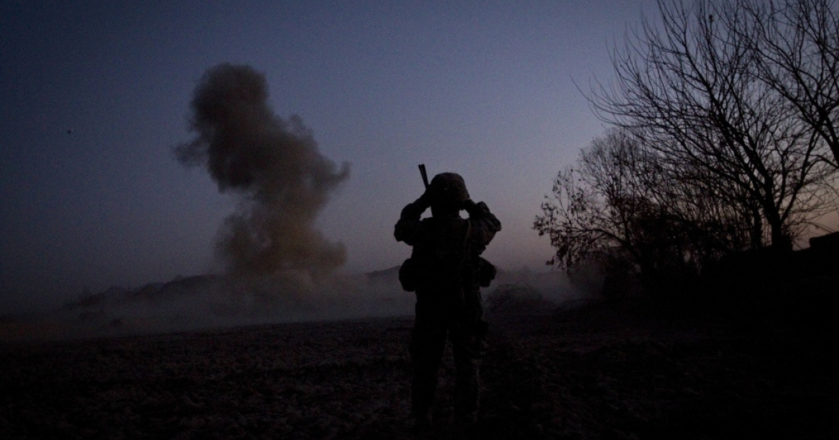 A U.S. soldier watches an explosion while patrolling in Kandahar province.</p>