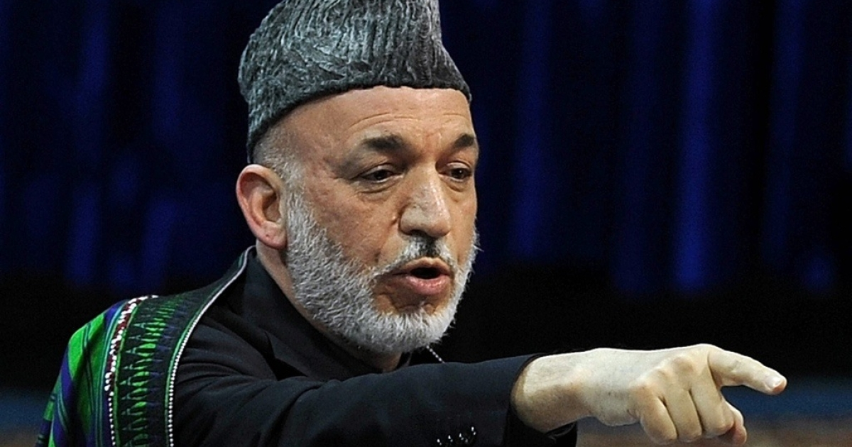 Afghan President Hamid Karzai speaks during the last day of a four-day long loya jirga, a meeting of over 2,000 Afghan tribal elders and leaders in Kabul on Nov. 19, 2011.</p>