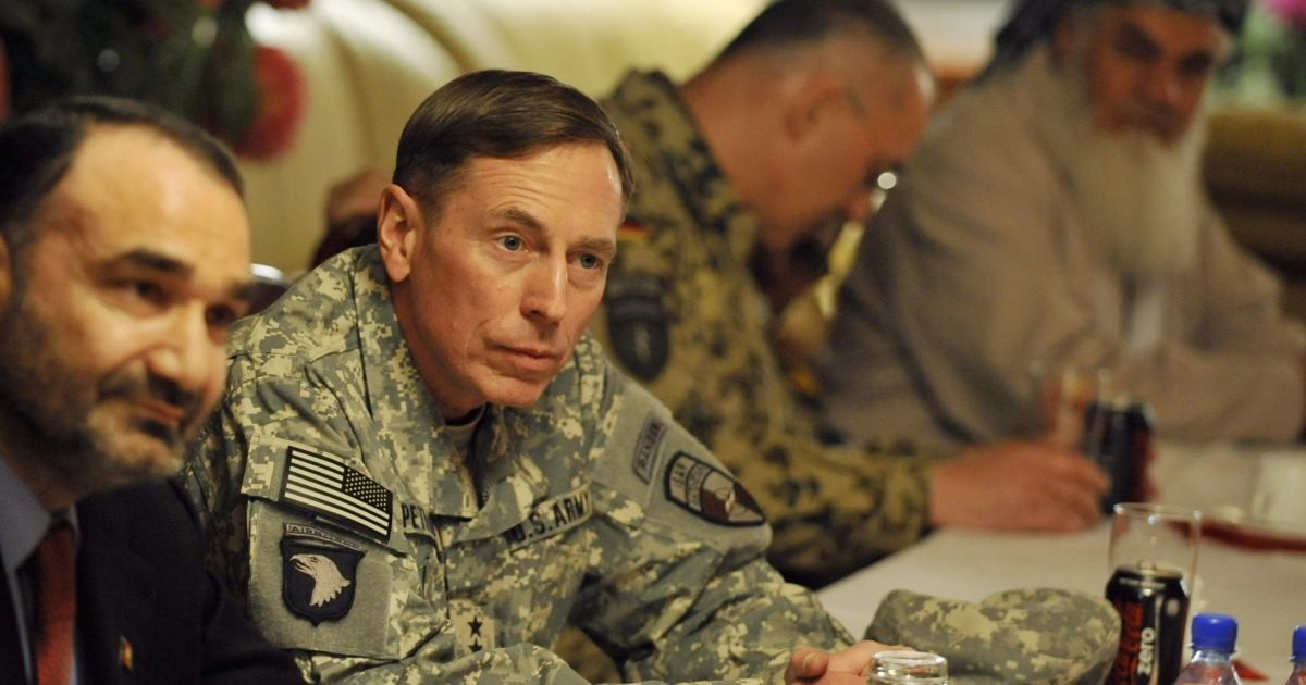 Gen. David Petraeus (2nd L) attends a meeting with German Chancellor Angela Merkel, former German Defense Minister Karl Theodor zu Guttenberg and Afghan President Hamid Karzai (not in picture) during an unannounced visit to the German Army's base in the Afghan city of Masar-i-Sharif on Dec. 18, 2010.</p>