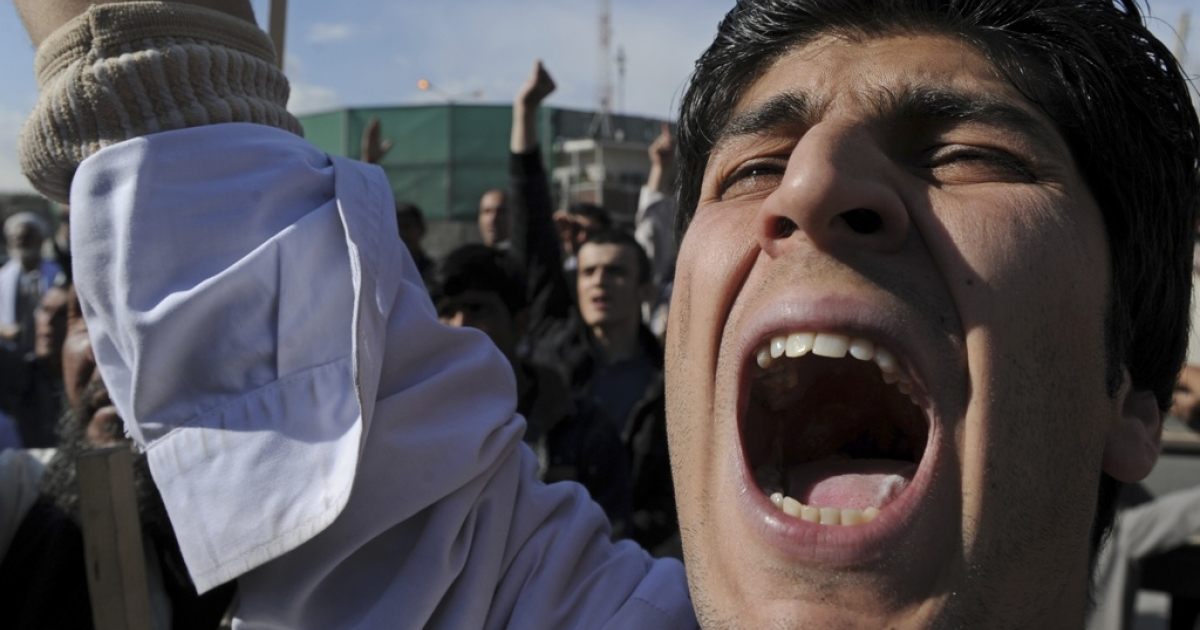 An Afghan protester shouts slogansduring a demonstration in Kabul on April 1, 2011.</p>