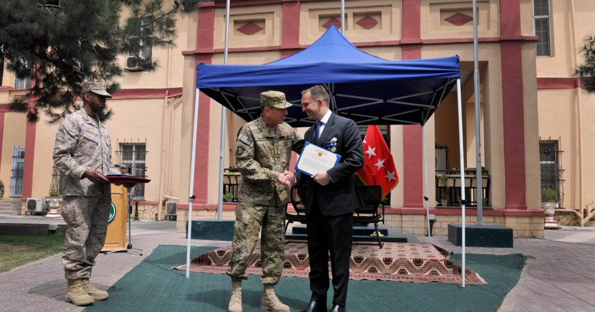 U.S. Army Gen. David Petraeus greets Ambassador Mark Sedwill, NATO's senior civilian representative, following a farewell ceremony for Sedwill on April 9, 2010 in Kabul, Afghanistan.</p>