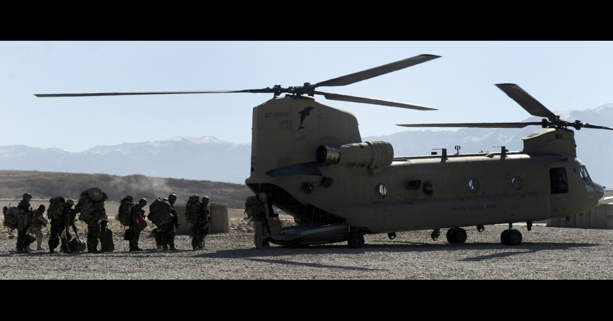 Soldiers of the NATO/ISAF joint task force prepare to board an US Airforce Chinook helicopter from the Tarin Kowt military airbase at Tarin Kowt on January 19, 2010. The Netherlands Royal Army leads the NATO/ISAF joint task force in the southern province of Afghanistan. About 113,000 foreign troops under US and NATO command are based in Afghanistan, with about 40,000 more due to be deployed this year to try to turn around the costly war against the resurgent Taliban. DESHAKALYAN CHOWDHURY/AFP/Getty Images</p>
