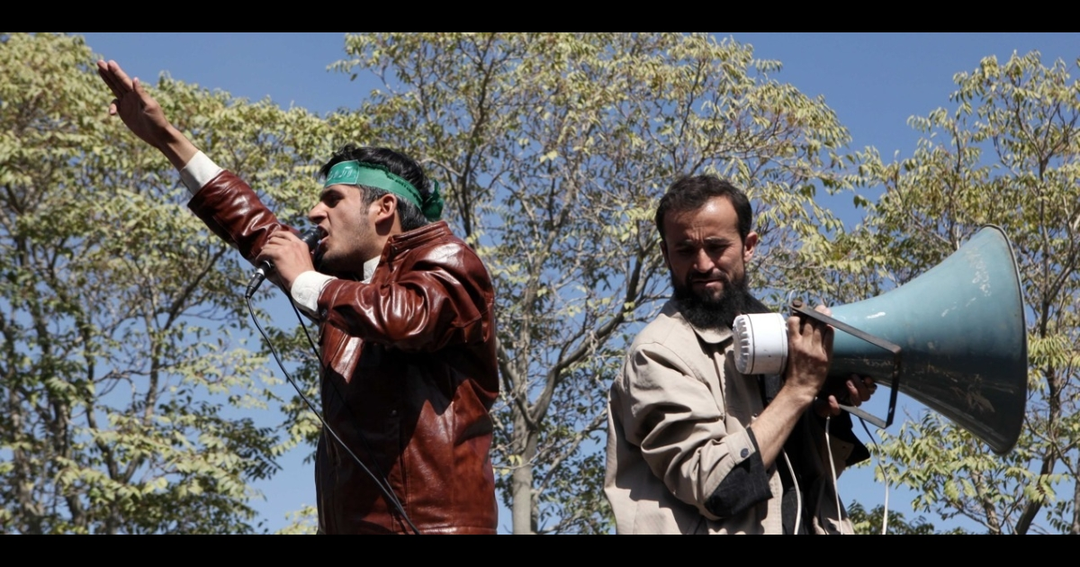 Afghan university students shout anti-US slogans.</p>