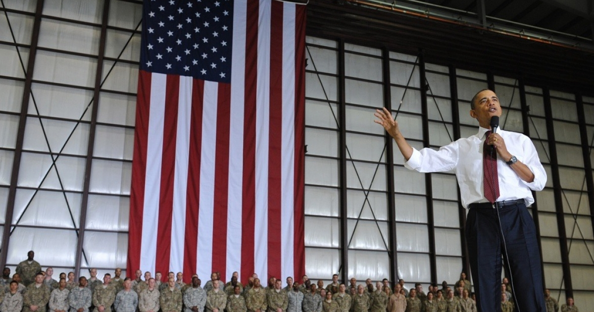 US President Barack Obama speaks to troops during a visit to Bagram Air Field on May 1, 2012 in Afghanistan. Obama signed an US-Afghanistan strategic partnership agreement during his unannounced visit to the country.</p>