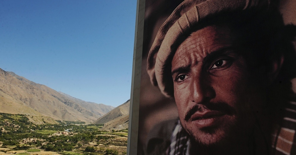 A portrait of national hero Ahmad Shah Massoud, the Northern Alliance leader who fought the Soviet Union and the Taliban, overlooks his grave site in Afghanistan.</p>