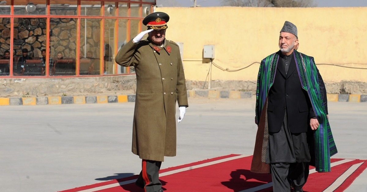 Afghan President Hamid Karzai inspects a guard of honor before inaugurating the new parliament in Kabul on Jan. 26, 2011.</p>
