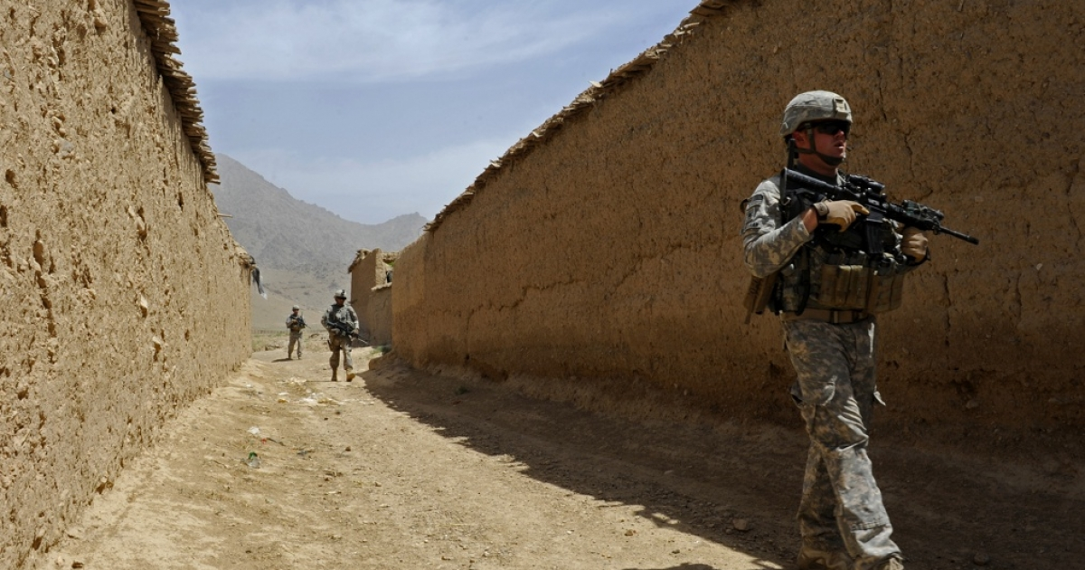 U.S. soldiers in Zabul, Afghanistan walk to meet with village elders on May 27, 2011.</p>