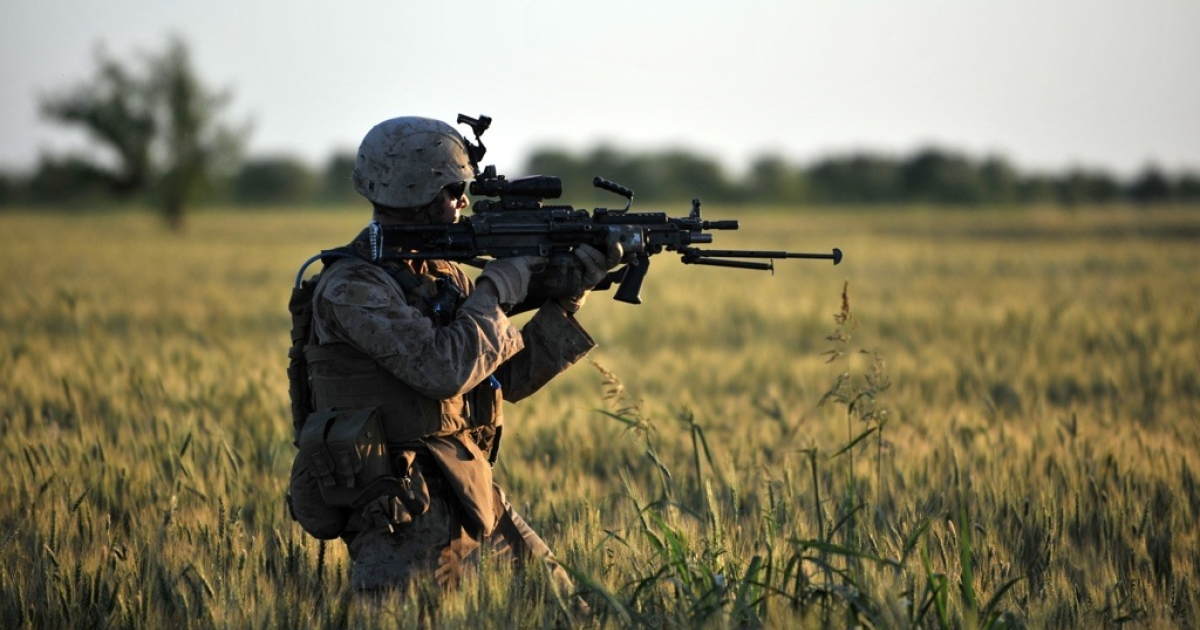 A US Marine gets ready to open fire in Helmand Province on May 7, 2011.</p>