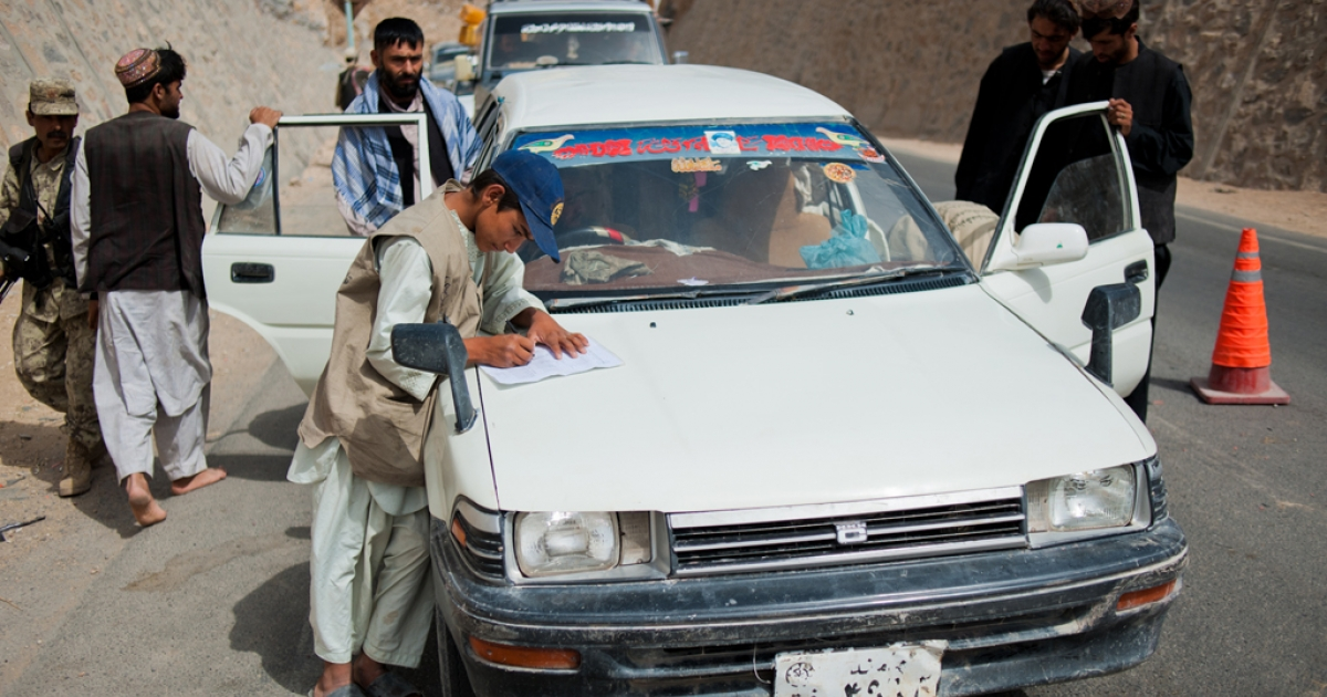 At a busy traffic checkpoint, cars traveling from Arghandab into Kandahar City are searched for weapons.</p>
