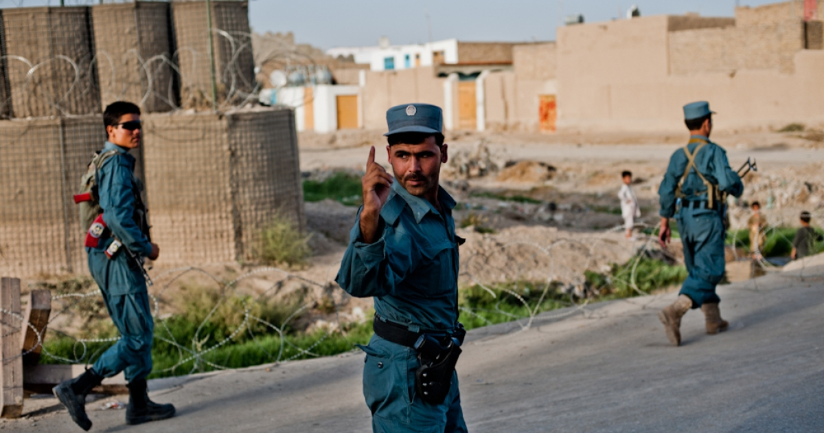 Afghan Police officers leave Police Substation 1 for a patrol in Kandahar City on July 13.</p>