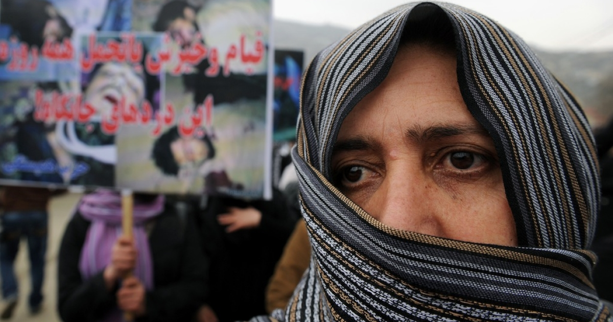 Afghan protesters shout slogans during a demonstration following the killing of nine children by NATO troops in the province of Kunar, in Kabul on March 6, 2011.</p>