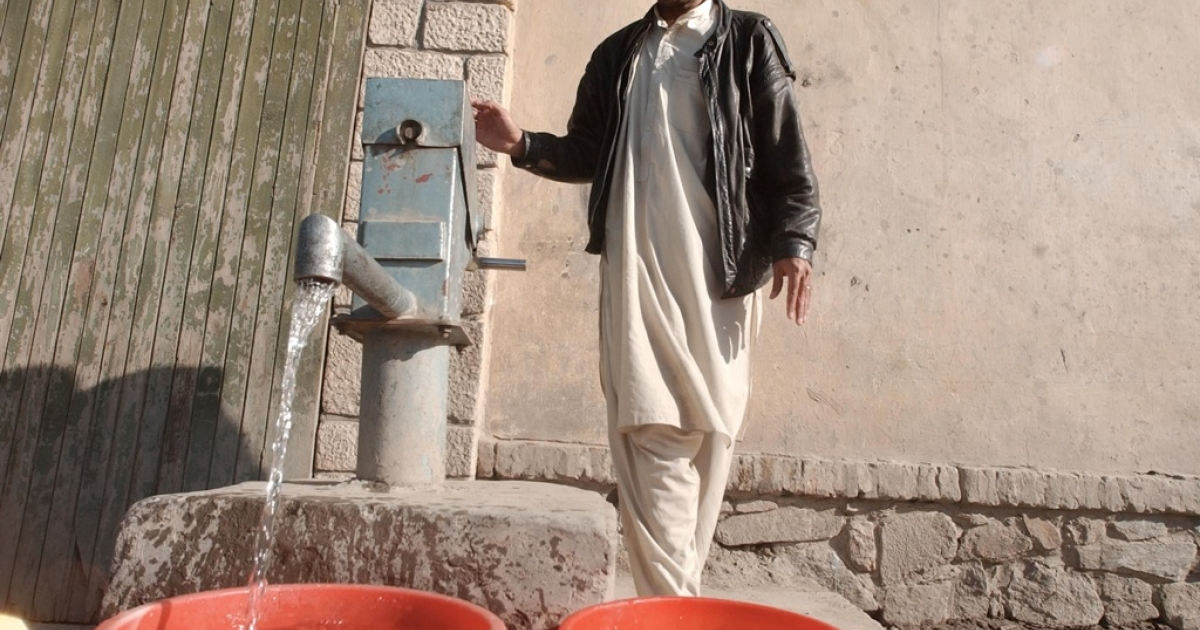 An Afghan man pumps water from a well March 11, 2003 in Kabul, Afghanistan. A six-year drought has dried up dams and forced workers to drill wells and hand dig tunnels in efforts to bring water into the cities.</p>