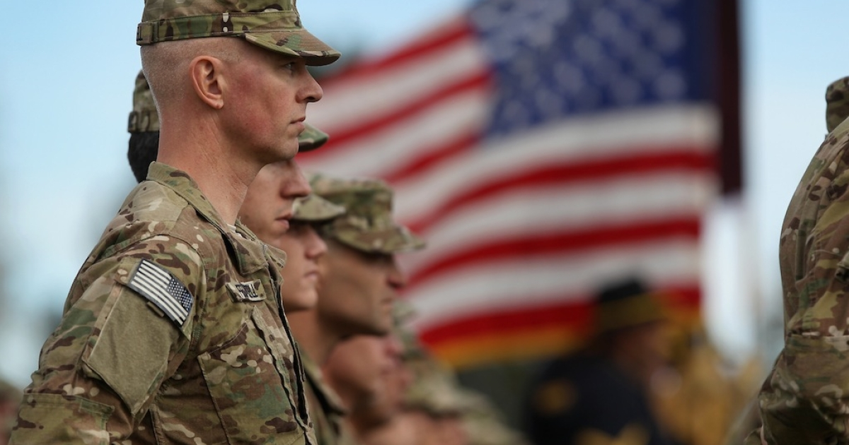 Soldiers bound for Afghanistan stand at parade rest during a departure ceremony on November 4, 2011 in Fort Carson, Colorado. A complete American troop withdrawal is expected by the end of 2014.</p>