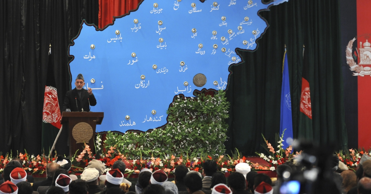 Afghan President Hamid Karzai speaks during a ceremony held to mark the start of the new educational year at The Amani High School in Kabul on March 23, 2011. Karzai rang the bell for the 8.3 million students expected to attend Afghanistan's school this year, where girls were once banned from attending school under the repressive Taliban regime which fell in 2001.</p>