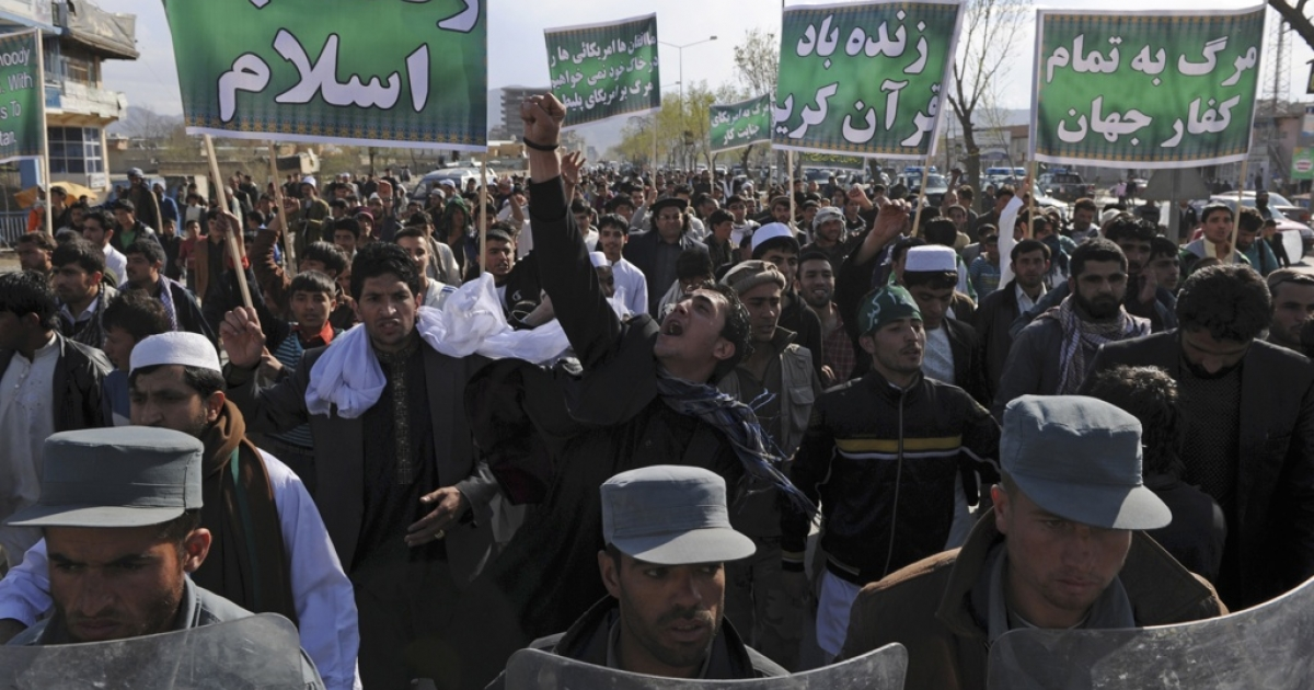 Afghan riot police lead a march as Afghan protesters shout slogans against the US, Israel, and England during a demonstration in Kabul on April 1, 2011. A number of people went on demonstration in Kabul on April 1 in protest to the burning of a Koran by a US evangelical preacher in Florida in mid-March.</p>