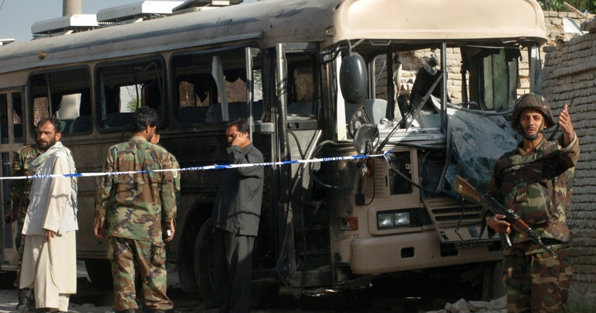 An Afghan National Army soldier stands guard at the site of a roadside bomb in Kabul, 03 May 2007. A bomb struck a bus taking Afghan soldiers to work in the capital Kabul killing the driver and wounding 14 people, police said. The bomb was hidden in a cart parked at the side of the road and was remotely detonated as the bus went by, an army officer said. 'It was a roadside bomb targeting an ANA (Afghan National Army) bus', the city's criminal investigation chief Alishah Paktiawal said.</p>